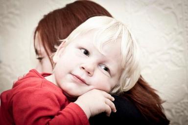 child hugging sister