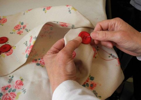 learning to sew buttons on