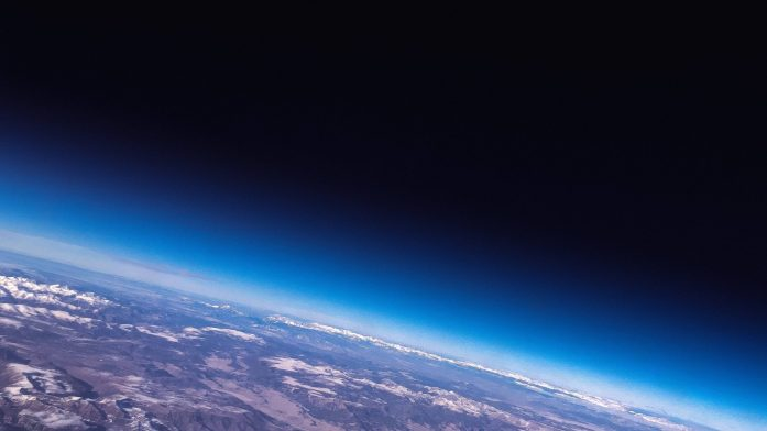 A digital image of earth as viewed from just outside it's atmosphere.