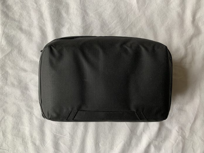 Tech Pouch from Peak design as viewed from the outside. Sleek black, matching backpack.