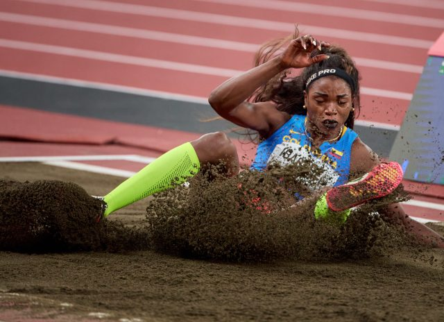 Photograph of Columbia's Caterine Ibarguen in the women's triple jump final during the Tokyo 2020 Olympics at the Olympic Stadium in Tokyo, Japan.