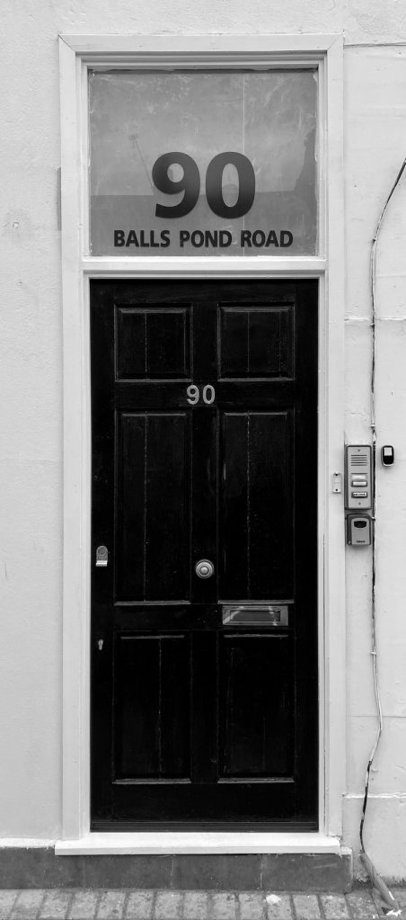 black wooden door with silver handle