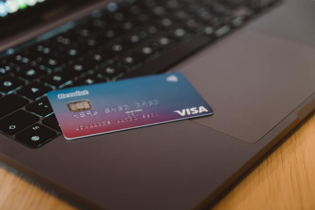 Blue and white visa card on a laptop