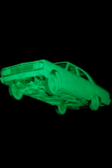 Glowing green floating car from the film Repo Man
