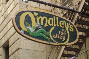 A photo of the sign outside of O'Malley's in the Alley in downtown Cincinnati