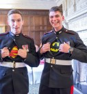 Groom and best man wearing marvel under their army uniform