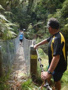 The marshal at the hanging bridge making sure no more than four people are simultaneously crossing.