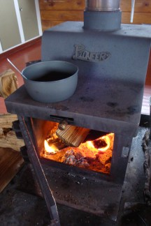 The Pioneer stove used for heat and cooking dinner.