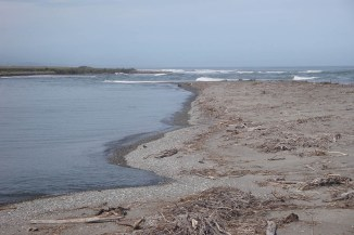 "The ""spit"" - a sand bank stretching into the sea creating a natural bay at Hokitika."