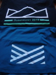 The race logo printed on the bottom back of the T-shirts.