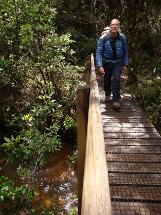 Gerry crossing the Golden rapids - yellow coloured due to the high iron content in the stream.