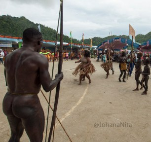 Men of the tribe MEE using tradisional attire that only cover the front