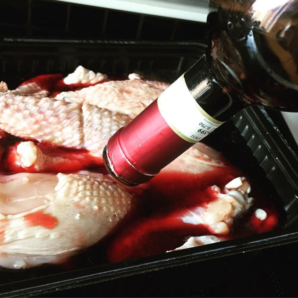 Pouring wine on Coq Au Vin