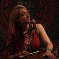 Johanna playing harmonium