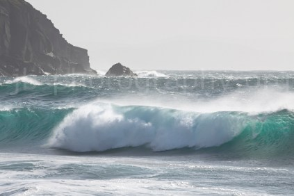 Surf rolling into Coumeenoole Bay