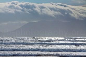 Surf on Inch beach, storm clouds over Macgillyguddy's Reeks behind (© Johann Brandstätter Photography)