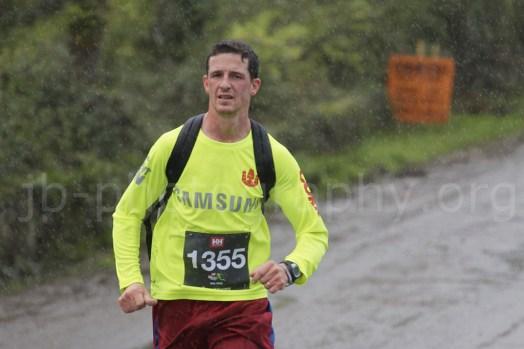 Runner in pouring rain