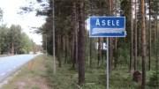 Vandaliserad samisk vägskylt i Sjeltie