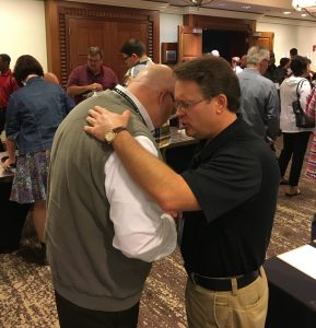 Pastors praying for one another