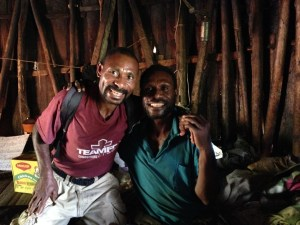 Ben Samauyo, our Kamea Bible translator, holding Benjamin Luke, our handicapped brother