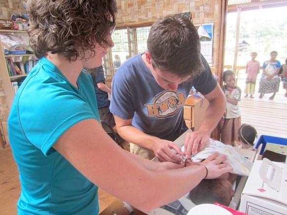 Interns help with newborn clinic.