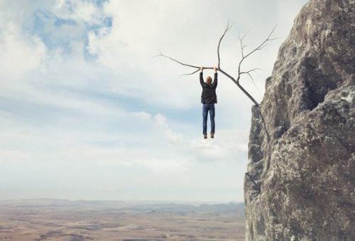 bigstock-Business-man-climbs-a-mountain-51486469