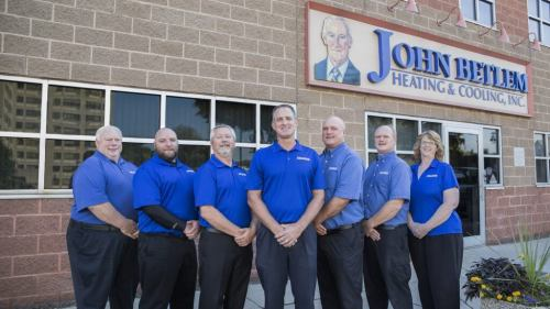 John Betlem employees standing outside shop.