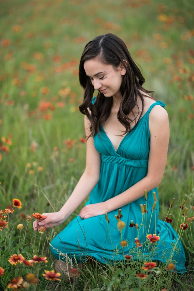 high school senior girl in a field of orange flowers