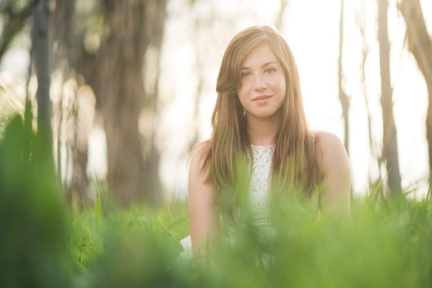 denver high school senior photo in grass