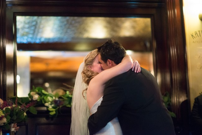 downtown denver wedding photography bride and groom kiss