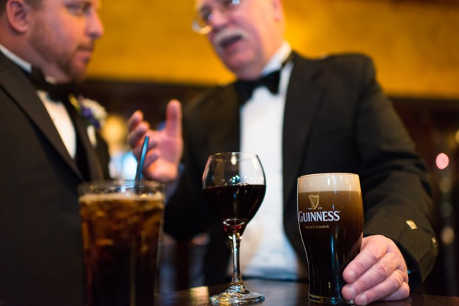 downtown denver wedding photography guests talk with guiness beer