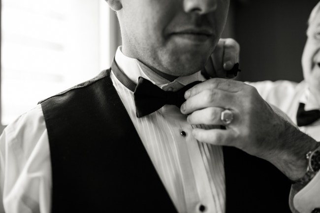 downtown denver wedding photography groom adjusting bowtie