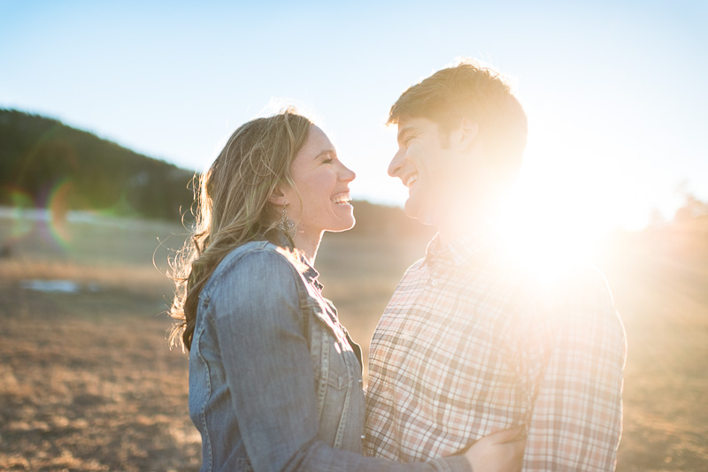 evergreen engagement photos in a sunny field