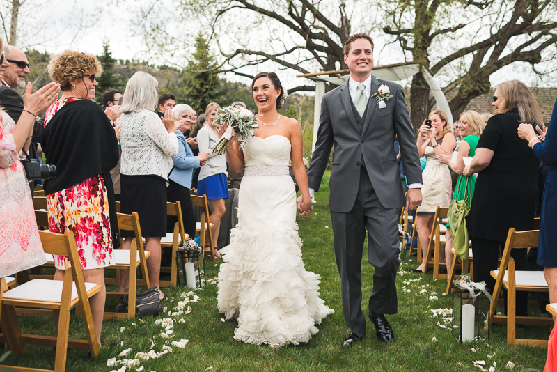Spruce Mountain Ranch Wedding Photography happy bride and groom leaving
