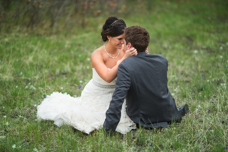 Spruce Mountain Ranch Wedding Photography bride and broom sitting in grass