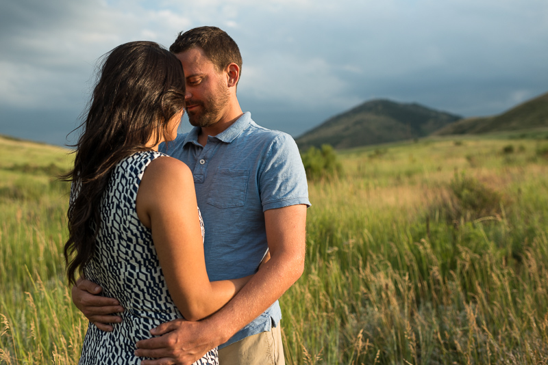Golden Engagement Photography couple in grass
