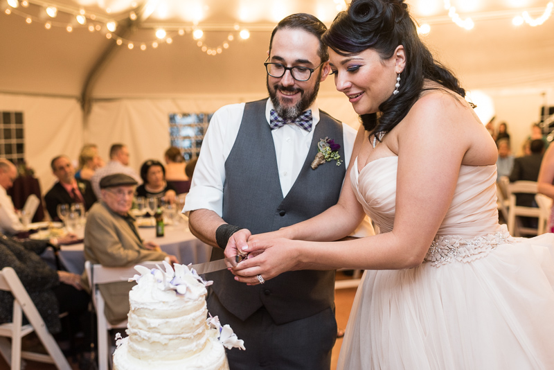 Denver Wedding Photographer Hudson Gardens cutting cake