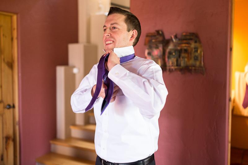 Golden Wedding Photographer groom tying tie