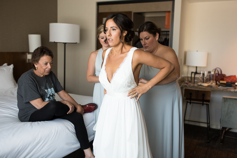 Denver Wedding Photography History Colorado bride putting on dress