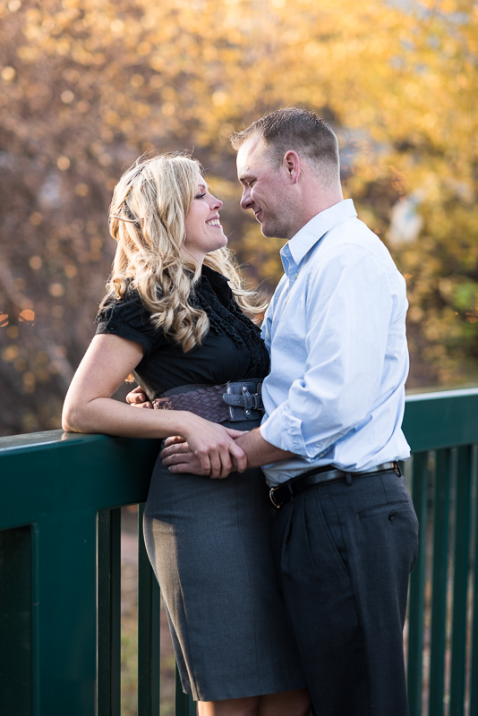 Denver Engagement Photographer standing on bridge