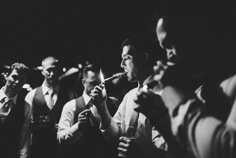 Denver wedding photography guys lighting cigars