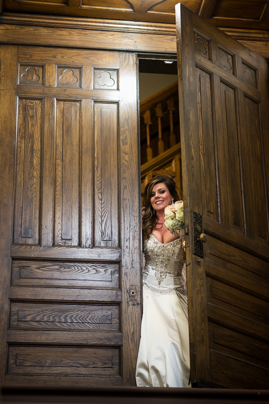 denver wedding photography bride peeking out door