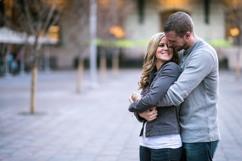 Denver Engagement Photography hugging in plaza