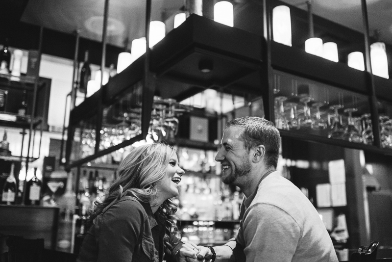 Denver Engagement Photography laughing in bar