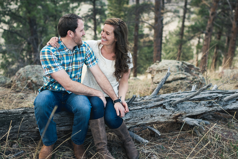 Boulder Engagement Photography laughing on a log