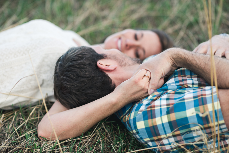 Boulder Engagement Photography laying in grass