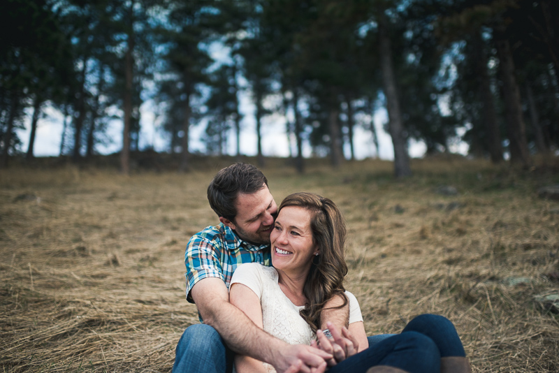 Boulder Engagement Photography laughing on hill