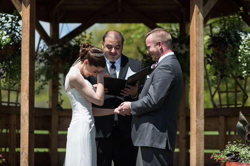 chatfield botanic gardens wedding photography bride wipes away tear