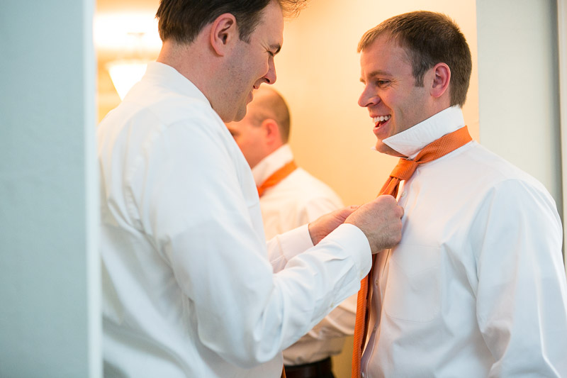steamboat springs wedding photography tying tie