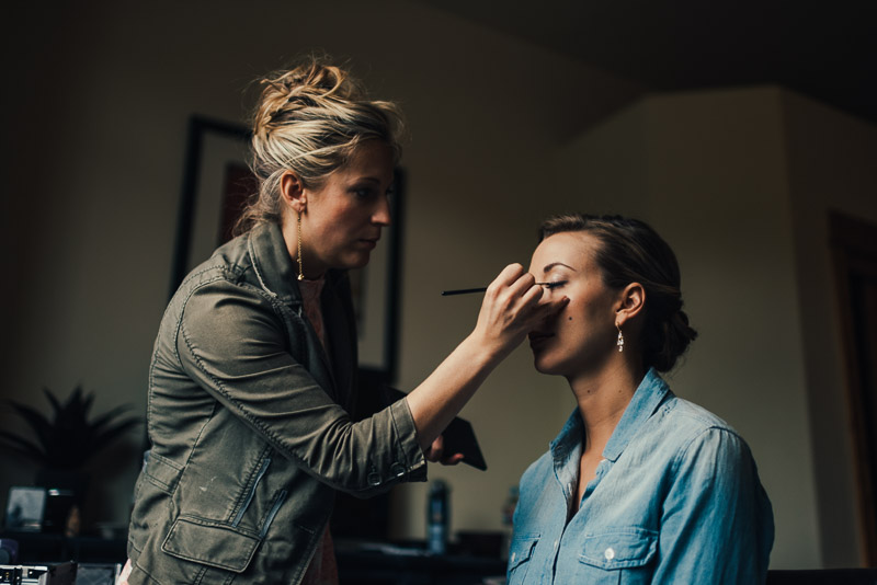 steamboat springs wedding photography bride getting makeup done